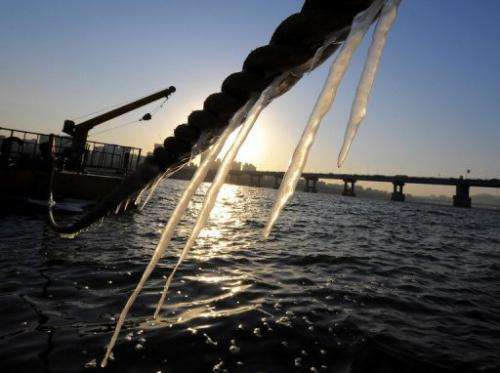 Icicles hang from a rope tied to a leisure boat on the Han river in Seoul, on January 24, 2007