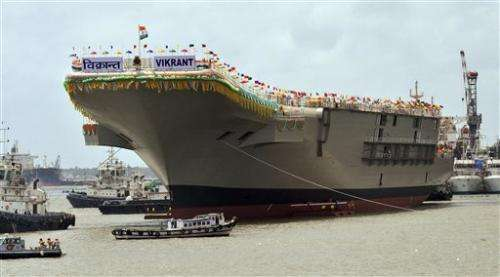 India unveils home-built aircraft carrier