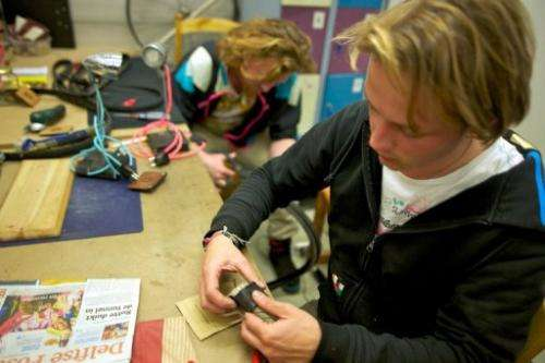 Industrial design students work on items made from recycled bicycle, May 17, 2013 in Delft