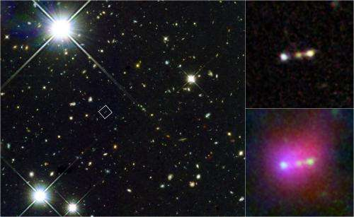 Infant galaxies merging near 'cosmic dawn'