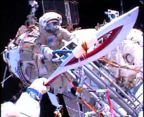 In this image obtained from NASA TV, Cosmonauts Oleg Kotov and Sergei Ryazansky (rear) perform a handoff of the Sochi 2014 Winte