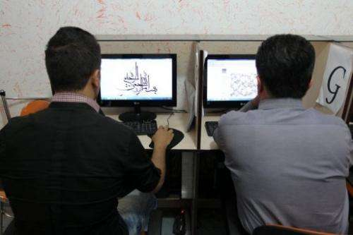 Iranians use computers at a cybercafe in Tehran, on May 14, 2013