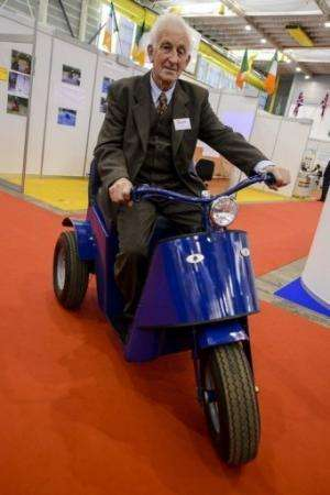 "James Dower sits astride the ""Tilt and Turn"" at the International Exhibition of Inventions in Geneva on April 10, 2013"
