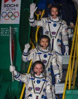Japanese astronaut Koichi Wakata (C), Russian cosmonaut Mikhail Tyurin (front) and US astronaut Rick Mastracchio pose with the S