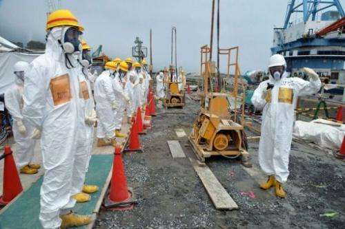 Japanese nuclear experts inspect the Fukushima Dai-ichi plant in Okuma, on August 6, 2013