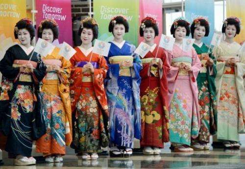 Japanese women clad in maiko costumes welcome members of the IOC in Tokyo on March 6, 2013