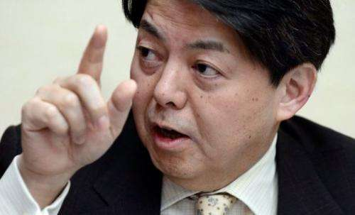 Japan's fisheries minister Yoshimasa Hayashi answers questions during an interview in Tokyo on February 26, 2013