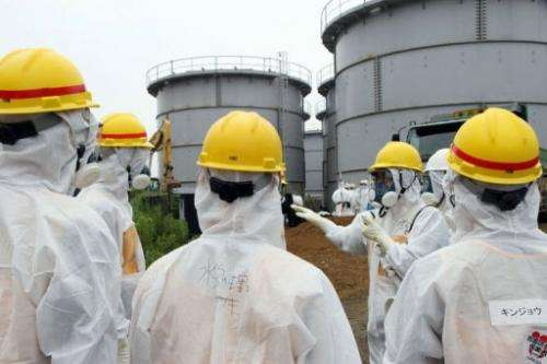 Japan's nuclear watchdog members inspect the Fukushima Dai-ichi nuclear power plant on August 23, 2013