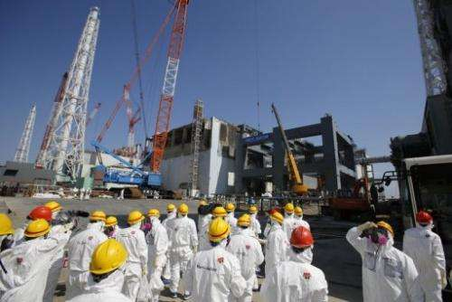 Journalists wear protective suits at the tsunami-crippled Fukushima Dai-ichi nuclear plant in Japan on March 6, 2013