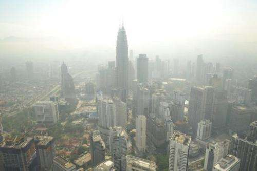 Kuala Lumpur's skyline is seen covered by haze, on June 27, 2013