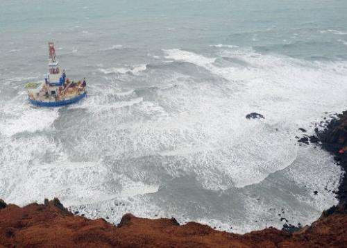 Kulluk drilling unit aground on the southeast shore of Sitkalidak Island, Alaska, January 1, 2013