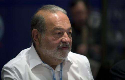 Mexican tycoon Carlos Slim attends a meeting in Mexico City on March 17, 2013