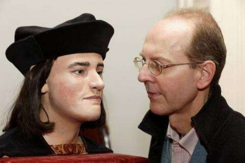 Michael Ibsen, a descendant of England's king Richard III, with a plastic model based on a CT scan the king's skull