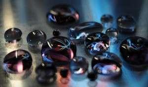 Milikelvins drive droplet evaporation
