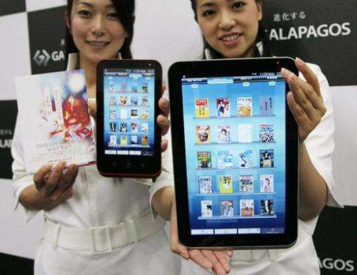 Models display Sharp's line of Galapagos tablet comptuers in Tokyo on November 29, 2010