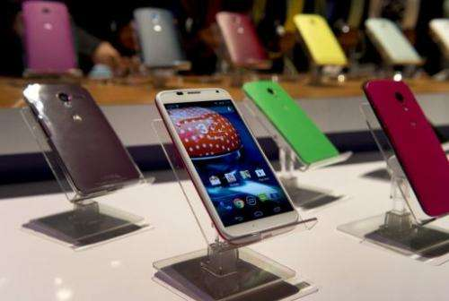Motorola smartphones are displayed on August 1, 2013 at a a news conference in New York
