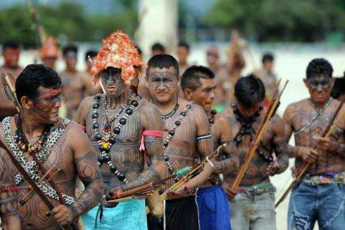 Munduruku people rally in front of the Planalto Palace in Brasilia, on June 6, 2013 to call for more say in the Belo Monte dam p