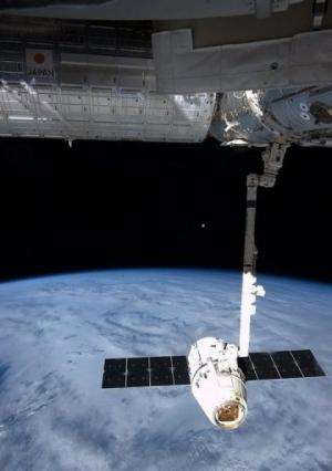 NASA image captured by astronaut Chris Hadfield on board the ISS on March 27, 2013 shows the Dragon capsule.