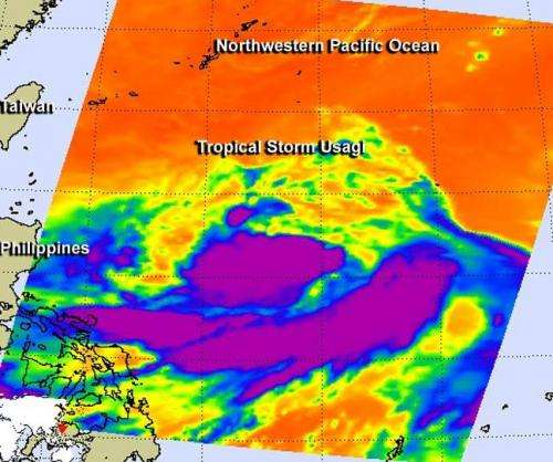 NASA spots wide band of strong thunderstorms south of Tropical Storm Usagi's center