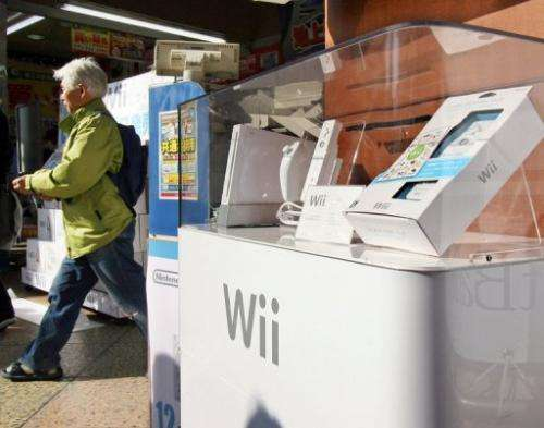 "Nintendo's video game console ""Wii"" is displayed at a Tokyo electronic shop on December 1, 2006"