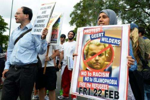 People protest outside the venue where right-wing Dutch MP Geert Wilders was speaking in Sydney, February 22, 2013