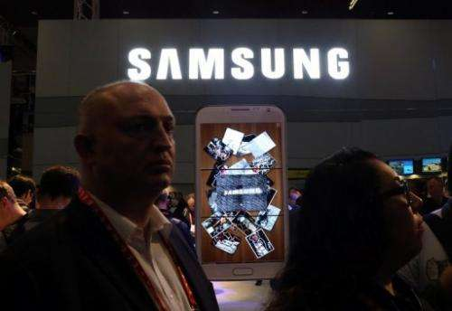 People visit the Samsung booth during the 2013 International CES in Las Vegas, on January 8, 2013