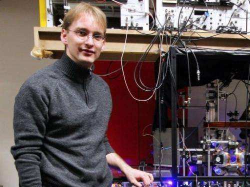 Physicist Jerome Lodewyck is pictured next to an atomic optic clock on March 19, 2009 in Paris