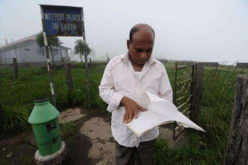 Ramkrishna Sharma, 53, in-charge of the rain-measuring int Mawsynram village, northeast India, June 21, 2013