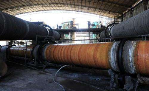 Rare earths undergoing processing in large steel pipes are cooled at a factory  in Inner Mongolia on April 21, 2011