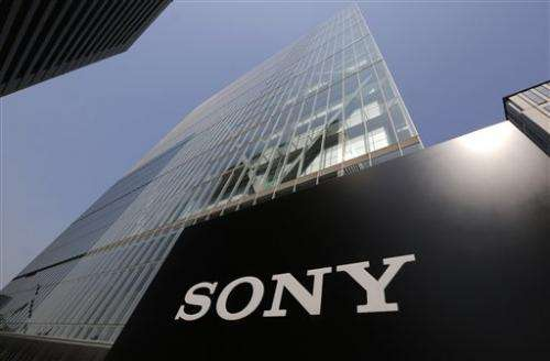 Red ink runs at Sony again, cuts profit forecast