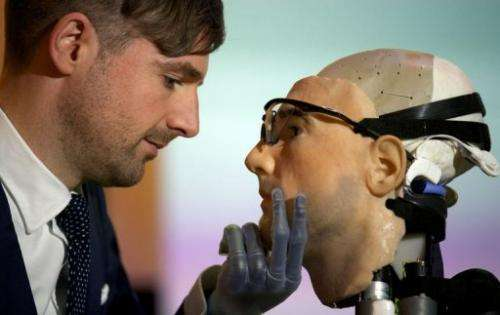 "Researcher Bertolt Meyer poses with the model for ""Rex"", the world's first ""bionic man"" in London on February 5, 2013"