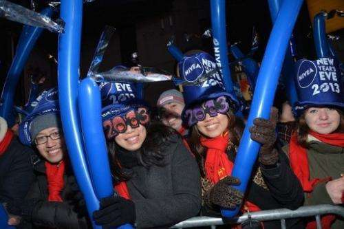 Revelers take part in new year's eve festivities in New York's Times Square on December 31, 2012