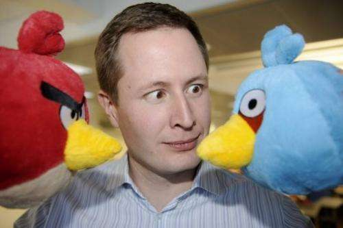 "Rovio CEO Mikael Hed poses with  two ""Angry Bird"" characters at the company premises in Espoo on January 21, 2011"
