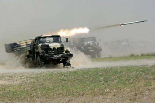 Russian-built rocket systems fire during military exercises in Tajikistan on June 10, 2012