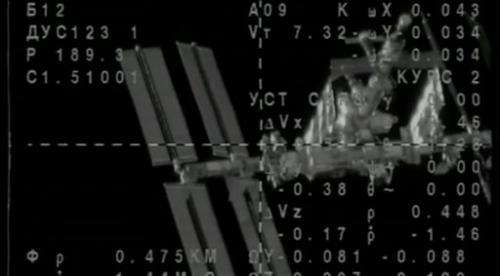 Russian spaceship docks with orbiting station