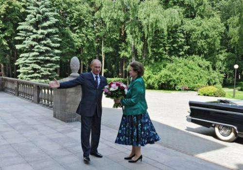 Russia's President Vladimir Putin with cosmonaut Valentina Tereshkova, at his  residence outside Moscow, on June 14 2013