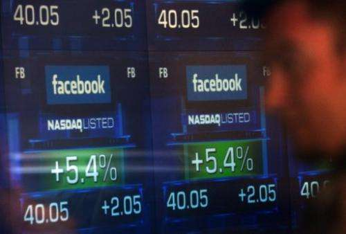 Screens display the start of trading in Facebook shares at the NASDAQ stock exchange, May 18, 2012