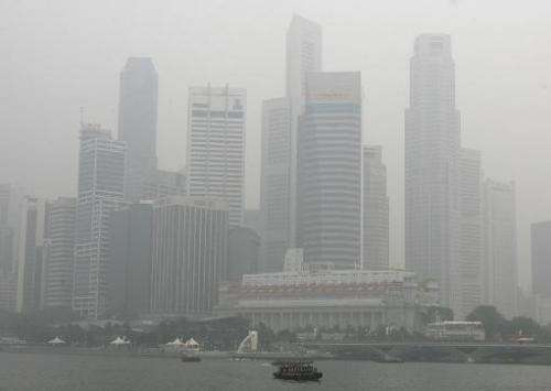 Singapore's skyscraper is seen enveloped in smog on October 16, 2006 from forests fires in Indonesia