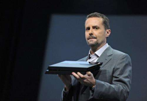 Sony CEO Andrew House unveils the new PlayStation 4 console at a press conference in Los Angeles on June 10, 2013