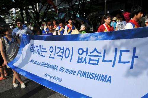"South Korean activists carry a banner reading ""No more Hiroshima, No more Fukushima,"" during an anti-nuclear protest i"