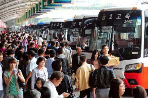 South Korean passengers queue at a bus termial in Seoul on September 10, 2011