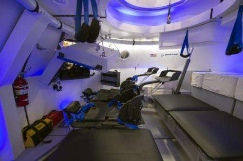 Spacesuited astronauts climb aboard Boeing CST-100 commercial crew capsule for key tests