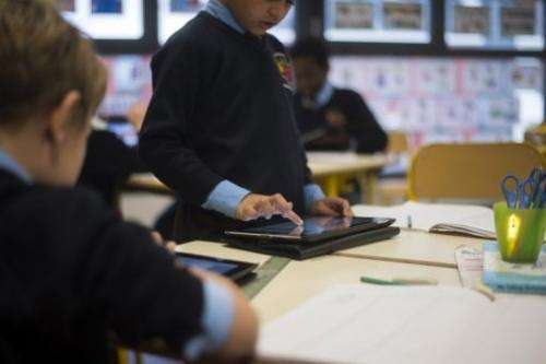 Students use Ipad digital tablets at the British School of Paris, on December 3, 2012