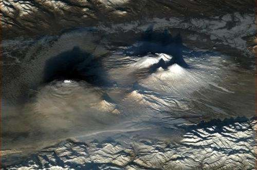 Stunning view from orbit: Dramatic volcanoes at dawn