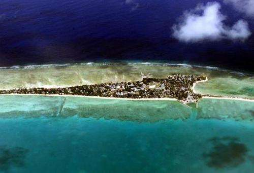 Tarawa atoll, capital of the vast archipelago nation of Kiribati which is under threat from climate change, pictured from above