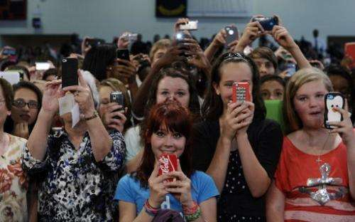 Teachers and students shoot photos and videos with their smartphones in Mooresville, North Carolina, on June 6, 2013