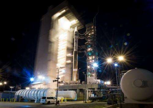 The Atlas-V rocket with Landsat Data Continuity Mission spacecraft onboard is revealed on February 11, 2013