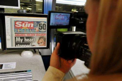 The front page of The Sun is seen on computer screen, in Broxbourne, outside London, on February 25, 201