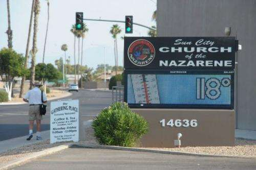The temperature reads 118F (48C) on a sign outside a church in Sun City, Arizona on June 29, 2013