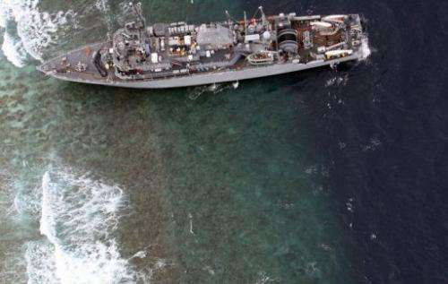 The USS Guardian is seen here on January 17, 2013 after it ran aground on the Tubbataha Reef in the Philippines